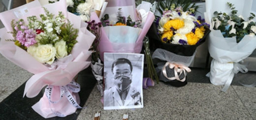 A photo of Li Wenliang is among the flowers people sent to the Central Hospital of Wuhan on Saturday. Photo: Cui Meng/GT