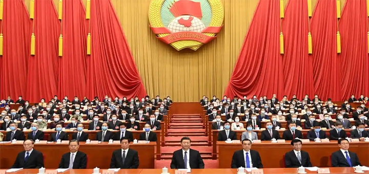 Li Keqiang (front row, third from right) with Xi Jinping (centre) at the opening of the national congress in Beijing on Friday. © Xinhua/REX/Shutterstock