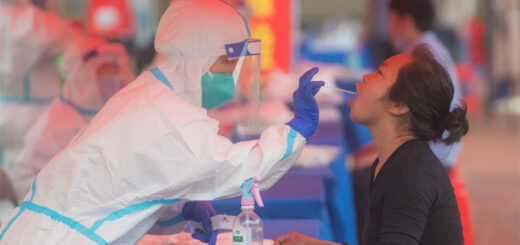 A resident takes a nucleic acid test for Covid-19 in Wuhan. © Xinhua