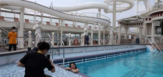 An internet show host poses in the swimming pool on the Explorer Dream cruise ship in Keelung, Taiwan, Cruise sailings have resumed, but with capacity reduced by two-thirds, no buffet service, and the on-board spa and casino closed. © Reuters