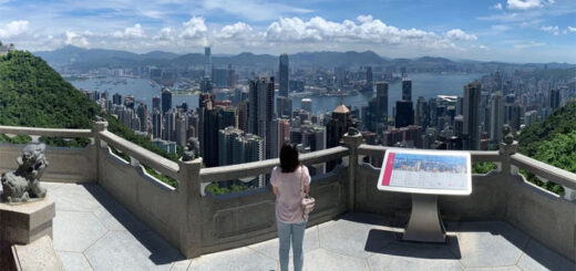 A woman looks out over the Hong Kong skyline from The Peak. © Nora Tam