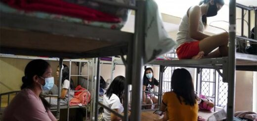 Domestic helpers who are between jobs gather at the boarding house run by Technic Employment Service Centre in Causeway Bay. © Sam Tsang