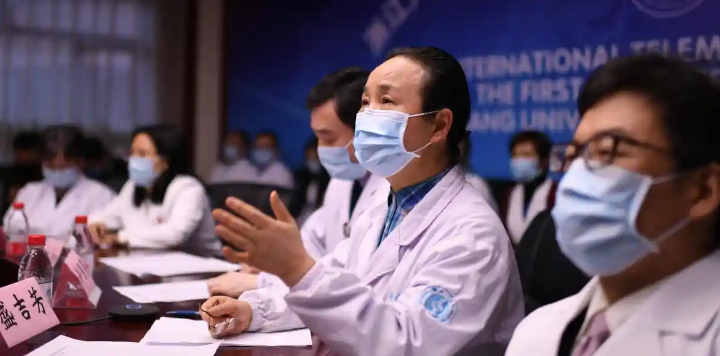 'Chinese doctors quickly warned their government and their government warned the world.' Chinese doctors in Zhejiang province hold a video conference with Italian medical experts on 27 March. © China News Service via Getty Images
