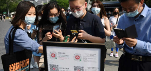 People with face masks have their health codes scanned in Beijing to get into a shopping centre on May 2. © AFP