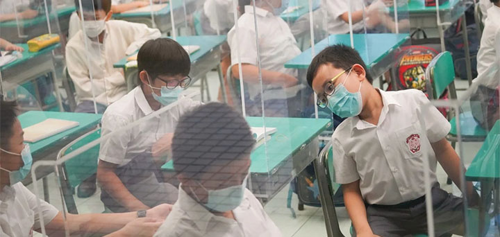 Students have returned to schools after long spells of off-and-on class suspensions due to the coronavirus pandemic. © Winson Wong