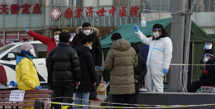 Residents line up for coronavirus tests at tents set up on the streets of Beijing on Sunday. © AP