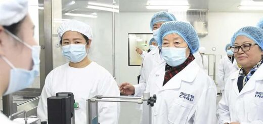 Vice-Premier Sun Chunlan (centre) visits the Beijing Institute of Biological Products on Wednesday. © Xinhua