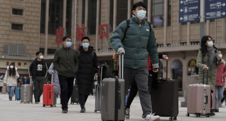 Passengers at Beijing's main railway station on Tuesday. © AP