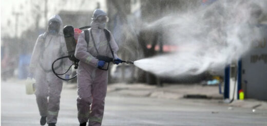 Workers spray disinfectant on a street in Shijiazhuang's Gaocheng district. © STR/CNS/AFP