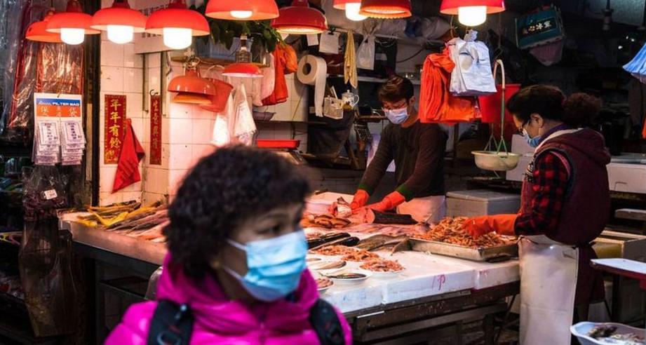 L'origine du virus pourrait être partie du marché de Wuhan en Chine. © AFP