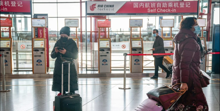 China is unlikely to relax its travel restrictions as it seeks to prevent importing new coronavirus cases. © Bloomberg