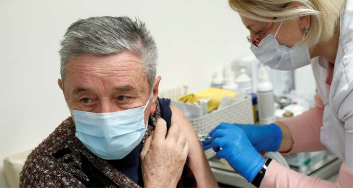 A man receives a dose of the Sinopharm coronavirus disease (COVID-19) vaccine, in Budapest, Hungary on February 26, 2021. © Agencies