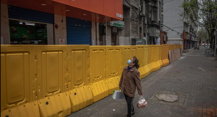 Wuhan went into lockdown for more than two months in January last year. Its death rate was found to be 56 per cent higher than estimates for the first three months of 2020. © EPA-EFE