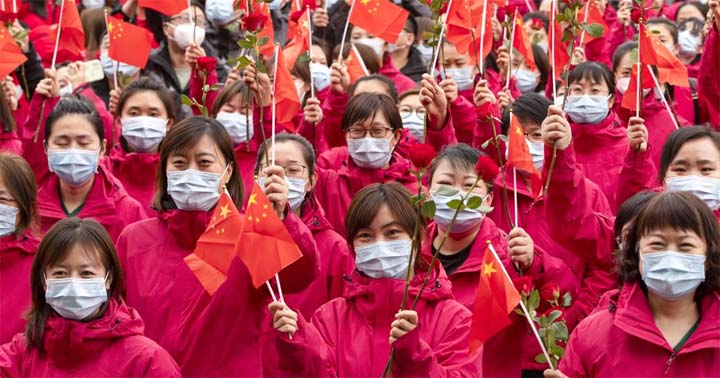 Medical workers from Jilin province take part in a farewell ceremony on Wednesday in Harbin, Heilongjiang, where they have been helping with mass testing during an outbreak in the city. @ Xinhua